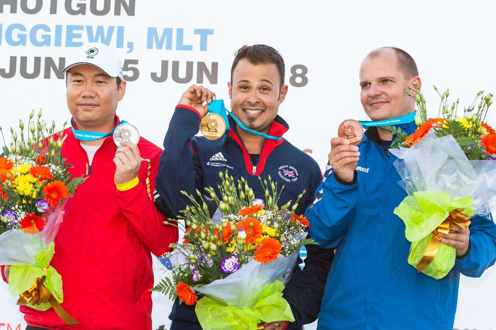 Aaron Heading with silver medalist Yu Du and third-placed Marian Kovacocy after the men's trap final at the Malta National Shooting Ranges. Photo by Nicolo Zangirolami