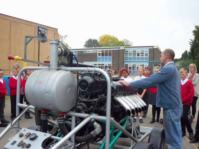 Darren Speechley shows pupils his Rolls Royce Merlin engine