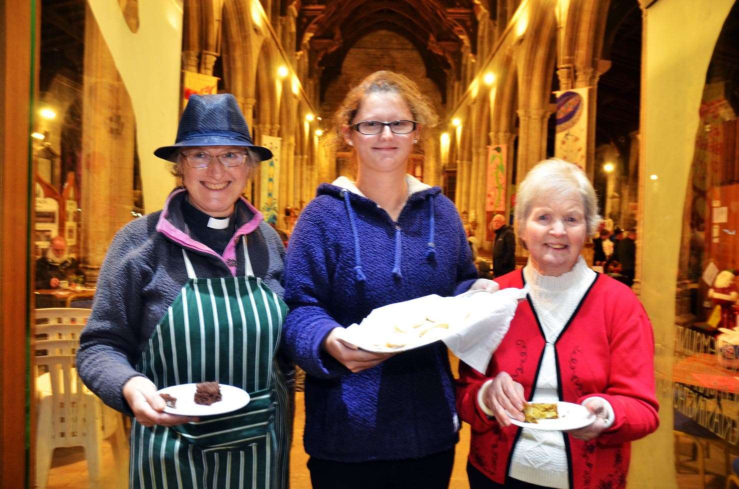 Cakes and hot drinks in the All Saints Church last year at the event. Pictured is: Rev Rosamund Seal, Autumn Ball and Joan Henderson.