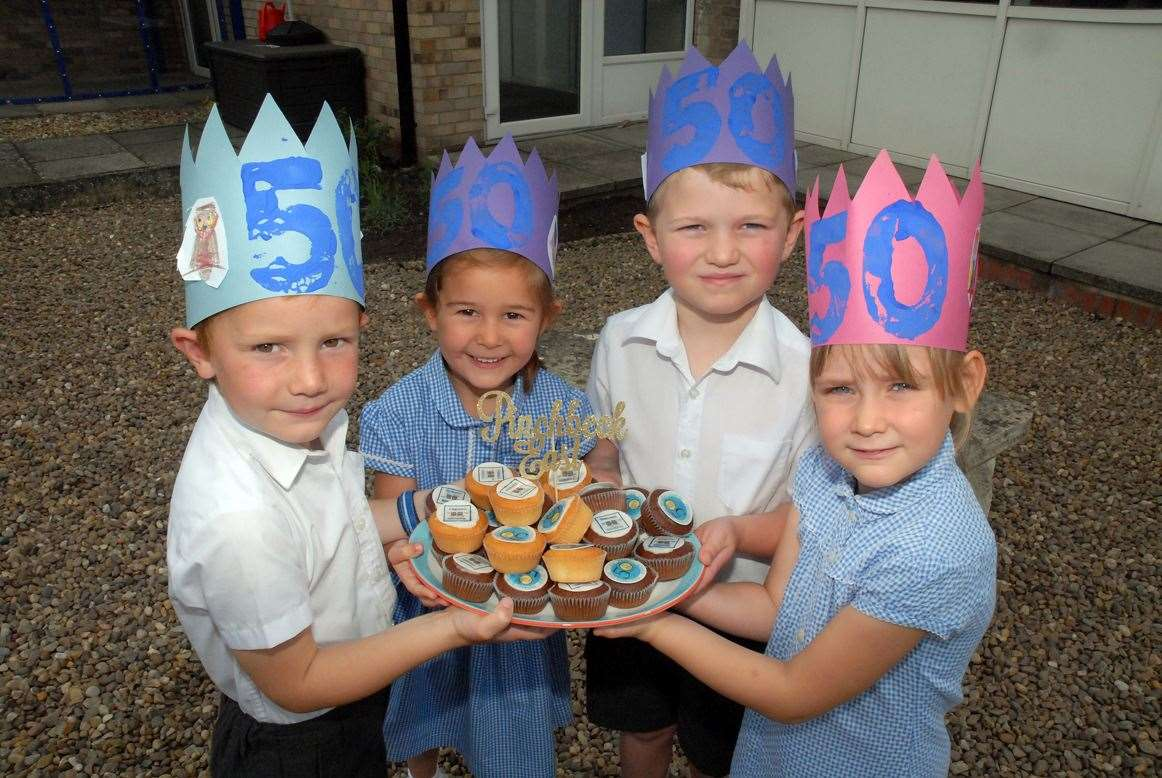 Alfie, Freya, Tom and Jamie with 50th anniversary party hats and celebration cakes.