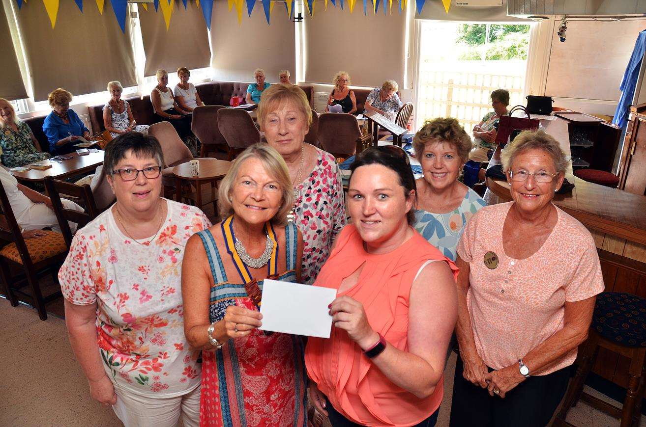 Inner Wheel pres to Lincs&Notts Air AmbulancePresident Jenny Symonds presents £650 to AA community fund raiser Faye Nam, looking on are members Linda Walters, Pauline Start, Sue Thomas, Carole Cooke (2783154)