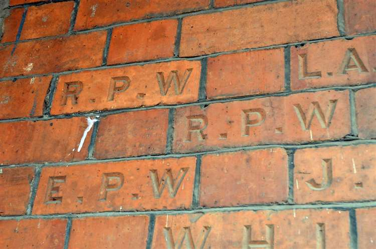 Bricks engraved with the initials of members of the Winfrey family, inset into Long Sutton Parish office, formerly the United Reformed Church. (4168418)
