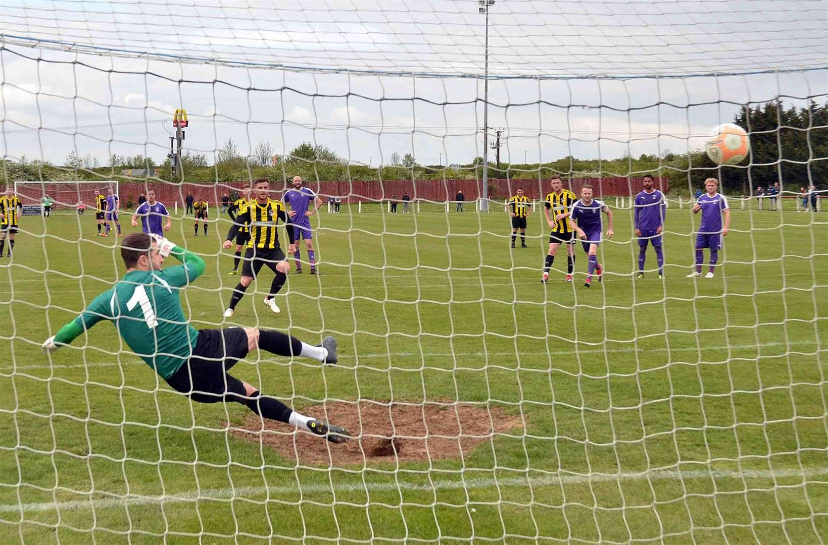 Josh Ford scores from the penalty spot.