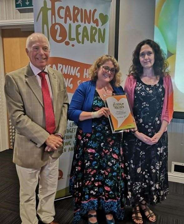 Manager Kathy Crouch (centre) and deputy manager Judith Sumner accept the Caring2Learn award on behalf of Abbey 345 Pre-School, Crowland, from Coun David Brailsford at Lincolnshire Showground.Photo supplied.