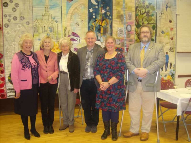 Pictured at the celebration are, from left: Trustees Lady Taylor, Jenny Worth, Trish Bryant (chairm), Chris Penney (treasurer), Carole Williams and Professor David Stocker from Heritage Lottery Fund.