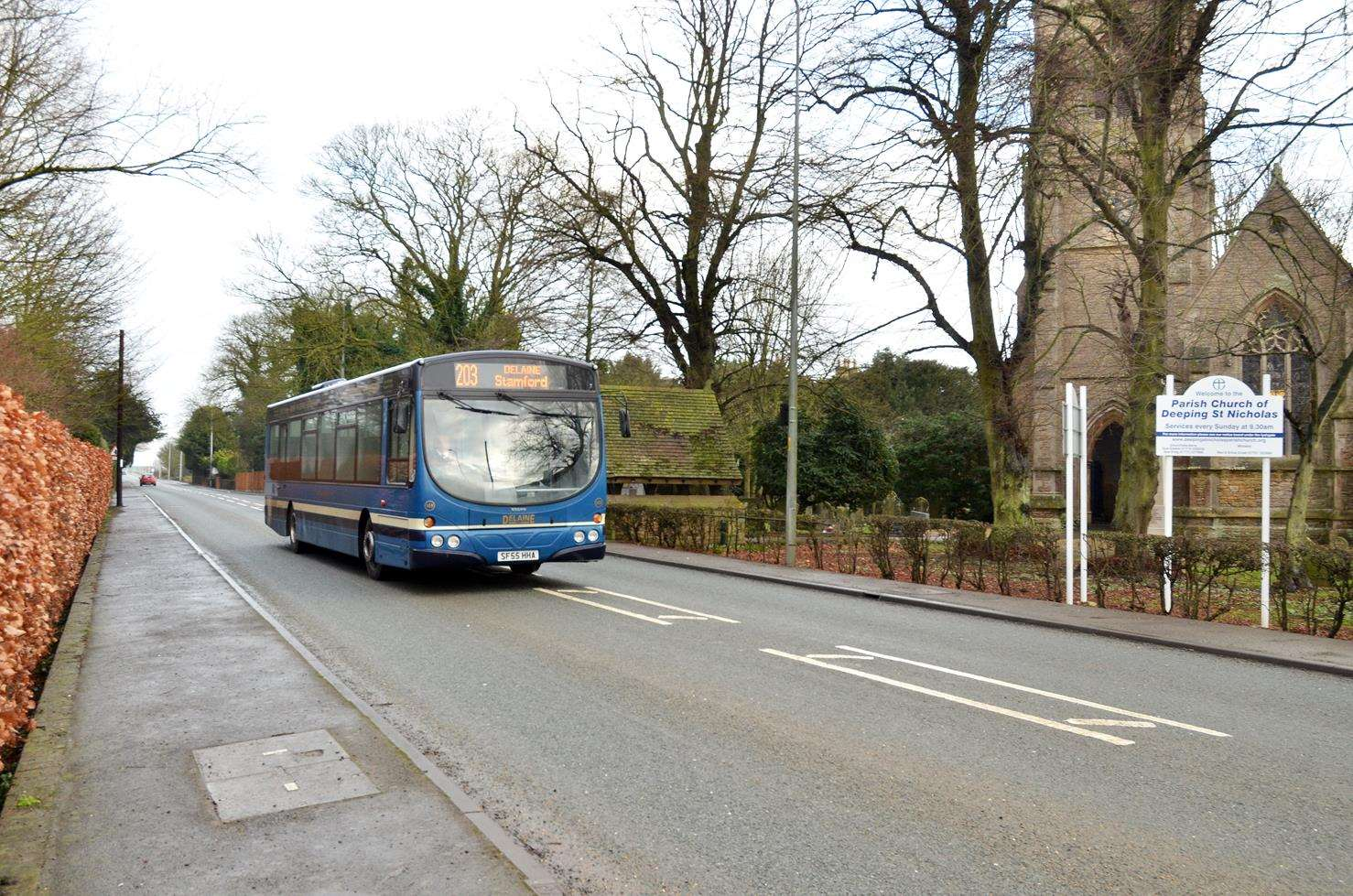 The new 203 Spalding to Stamford bus service passes by Deeping St Nicholas Parish Church. Photo (TIM WILSON): SG-250119-007TW.