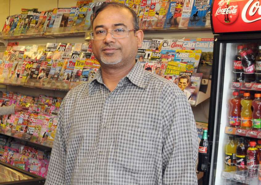 RAIDED AGAIN: Asgar Vanparekh IN Classic News in Sheep Market, Spalding, soon after taking over the shop in May 2015. Photo by Tim Wilson. SG030615-104TW.''''.