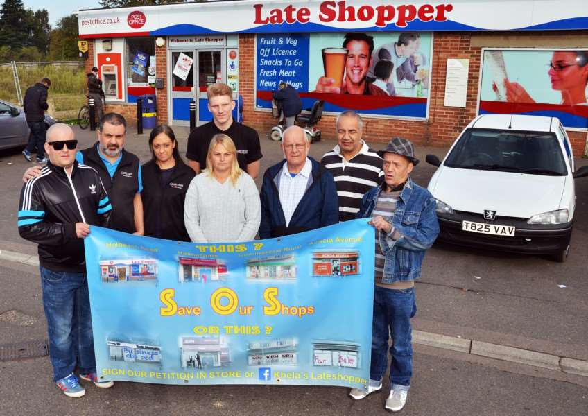 Ranjit Khela (second left) with brother Bill (second right), staff and customers ... and their Save Our Shops banner. SG300917-502TW