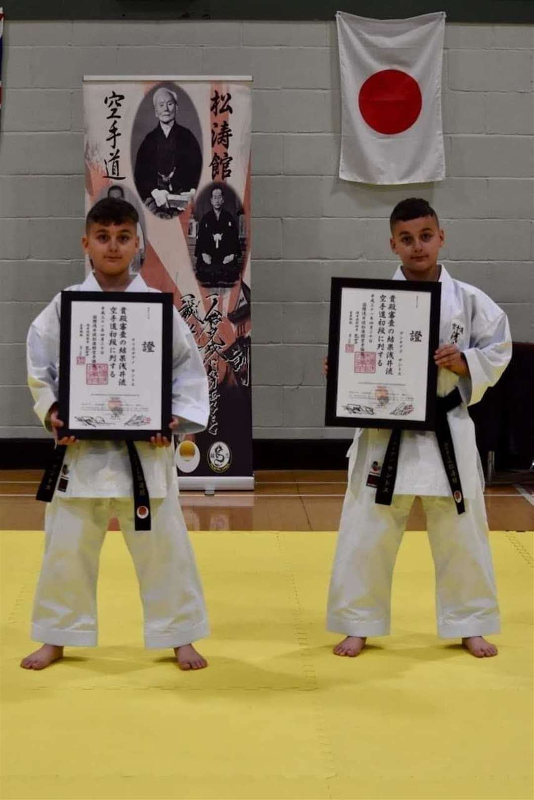 Cristiano (left) and santiago Santos after their black belt gradings (11855704)