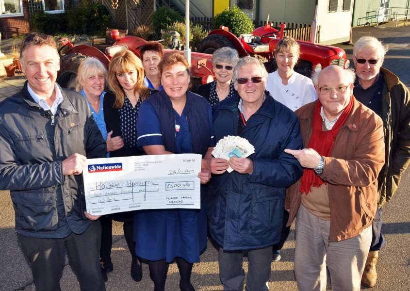 FLYING FUNDRAISERS: Maxine Winch (front centre) and Holbeach Hospital staff with Fenland Flywheelers' members Andrew French, David Bryant and John Ward. Photos (TIM WILSON): SG241117-151TW.