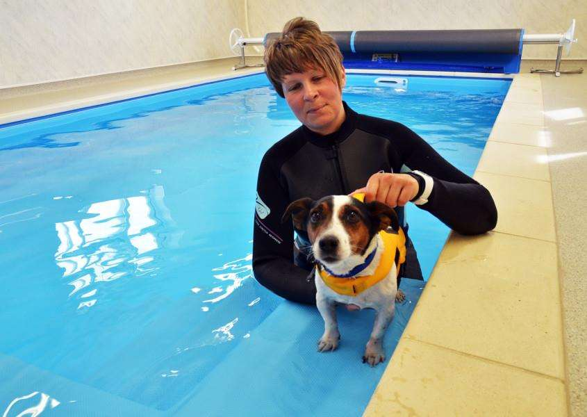 Clare Oakes and Mikey at her new Lexi's Aqua Pawz canine hydrotherapy centre in Donington. Photo by Tim Wilson. SG230418-116TW.