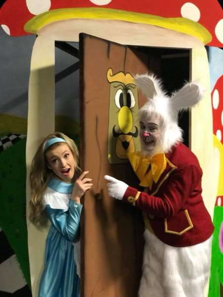 Alice and the White Rabbit in Alice in Wonderland at Baytree Theatre.