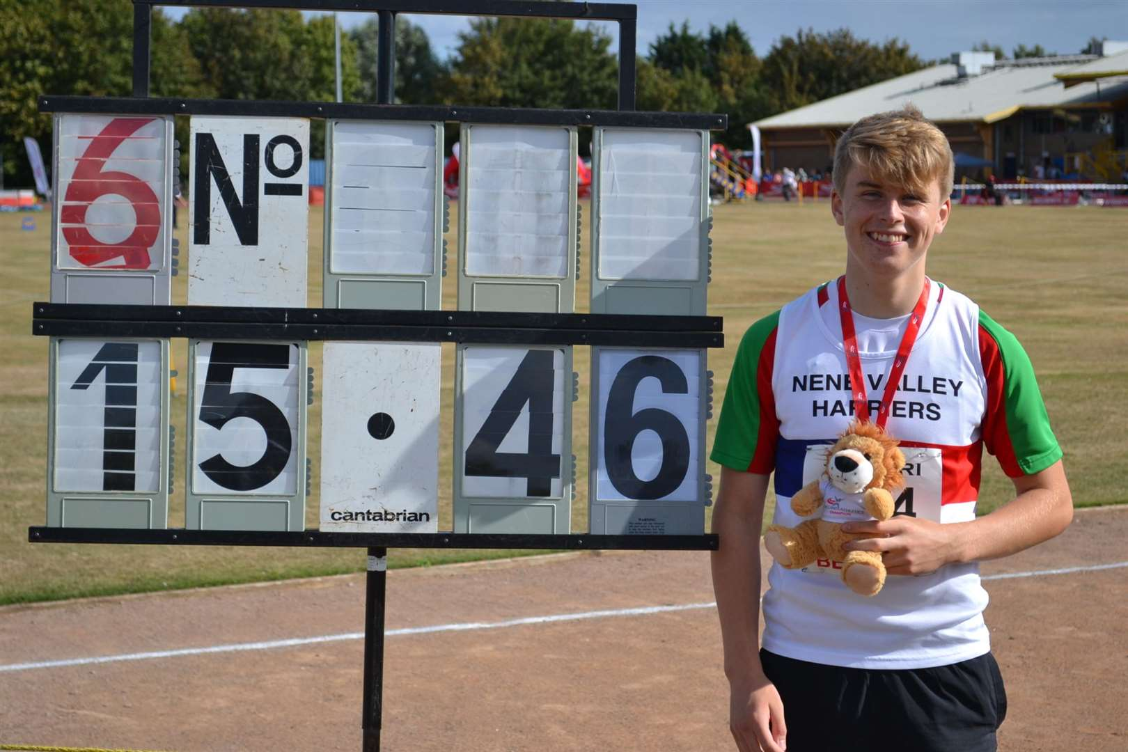 Donovan Capes next to his winning shot put distance at the England Athletics Under-15/Under-17 Championships in September.