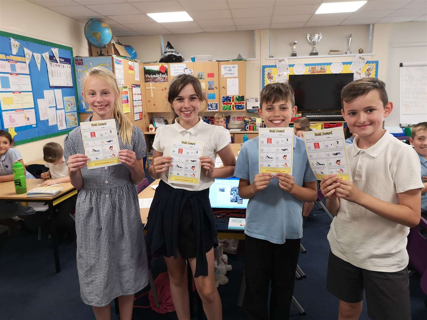 Pupils from Owls class with their Gold Awards