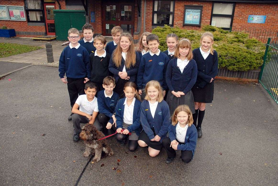 Pupils and school dog Brodie Pupils outside Long Sutton Primary School which is now part of Keystone Academy Trust.Photo (TIM WILSON): SG-151119-015TW