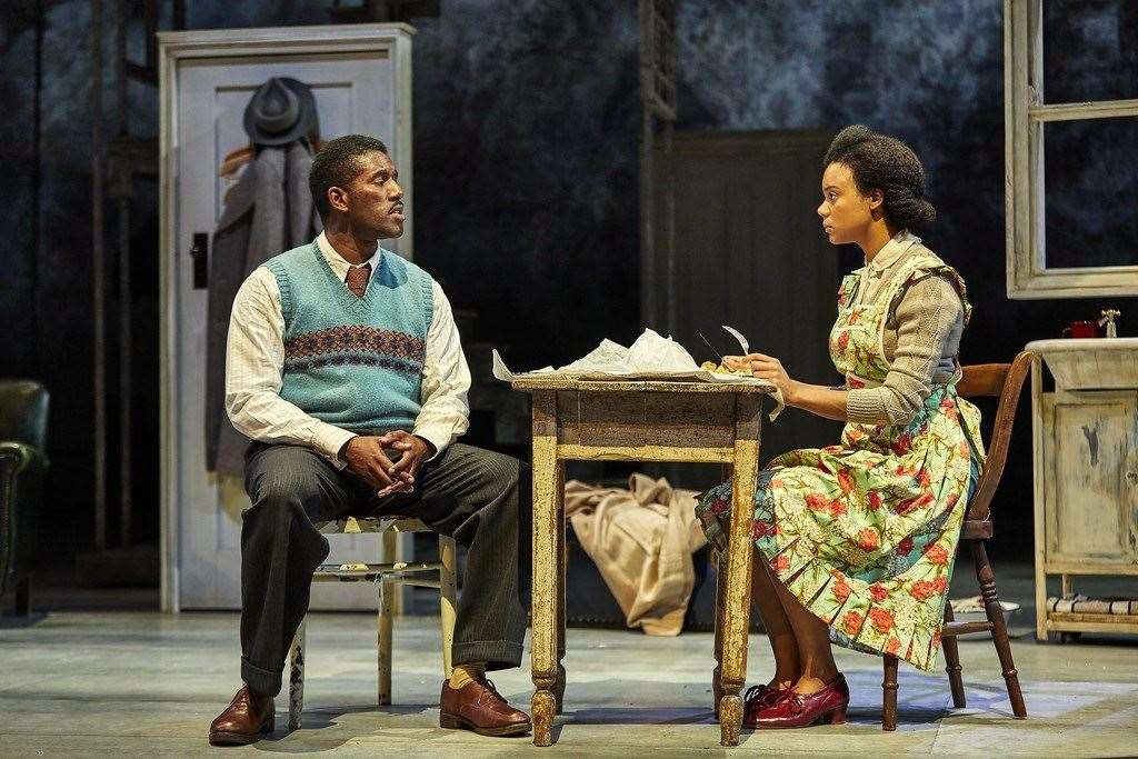 Leah Harvey (Hortense) and Gershwyn Eustache Jnr (Gilbert) in the National Theatre production, Small Island. Photo by Brinkhoff Moegenburg for NT Live.