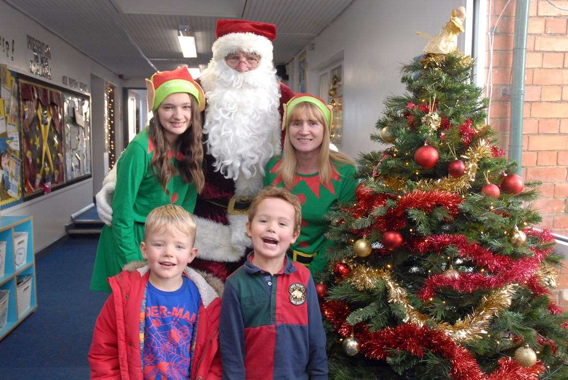 Santa and his elves with Ross and Wyn at Gosberton Academy Christmas Fair