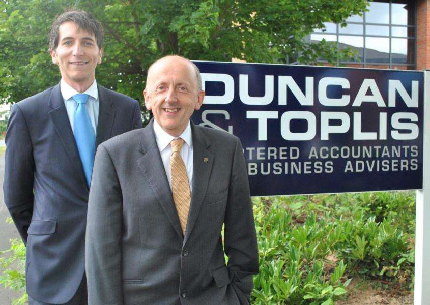 COMMUNITY MINDED: David Gratton (front) and Alistair Main, directors of Duncan and Toplis Chartered Accountants and Business Advisers in Pinchbeck. Photo supplied.