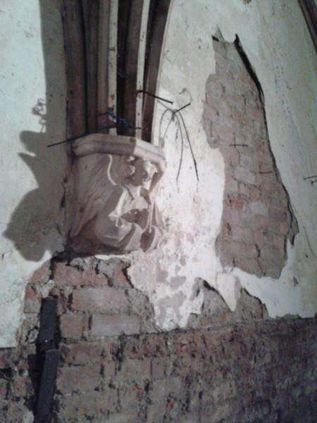 Funding is desperately needed to restore the chapels. This photo shows plaster coming away from the walls in the North Chapel.