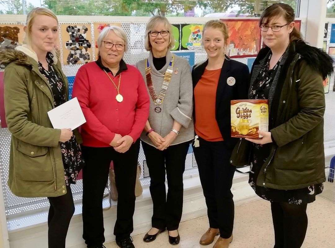 Kat West and Hannah Hallett from Market Deeping Community Primary School collect the Winning School prize from Deputy Mayor Councillor Xan Collins, Rotary President Jenny Spratt and Emma Ward of Tesco. (10664246)