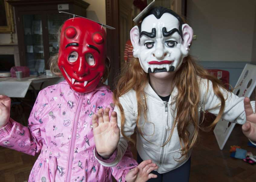 A Halloween children's event for Sue Ryder where Pippa and Emily Carlin where scary face masks. Photo by Michael Fysh. SG261017-025MF.