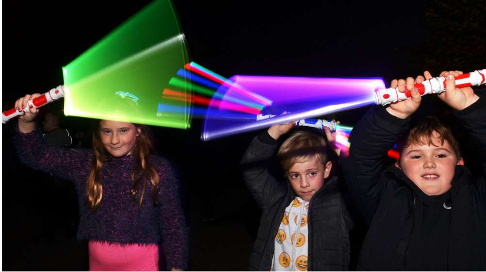 Layla Bacon, Lucas Sampson and Megan Taylor with light sticks. (SG031117-208TW).