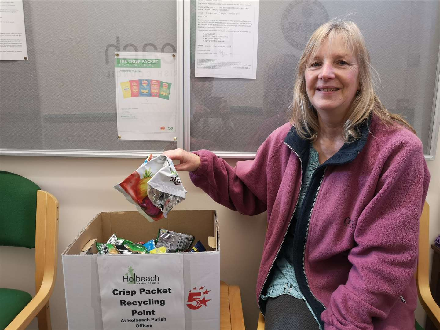 Coun Isobel Hutchinson and the crisp packet recycling point set up by Holbeach Parish Council.Photo supplied.