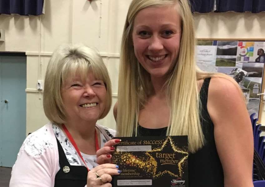 Amber during her weight loss, receiving a Slimming World award from Wendy Trevor