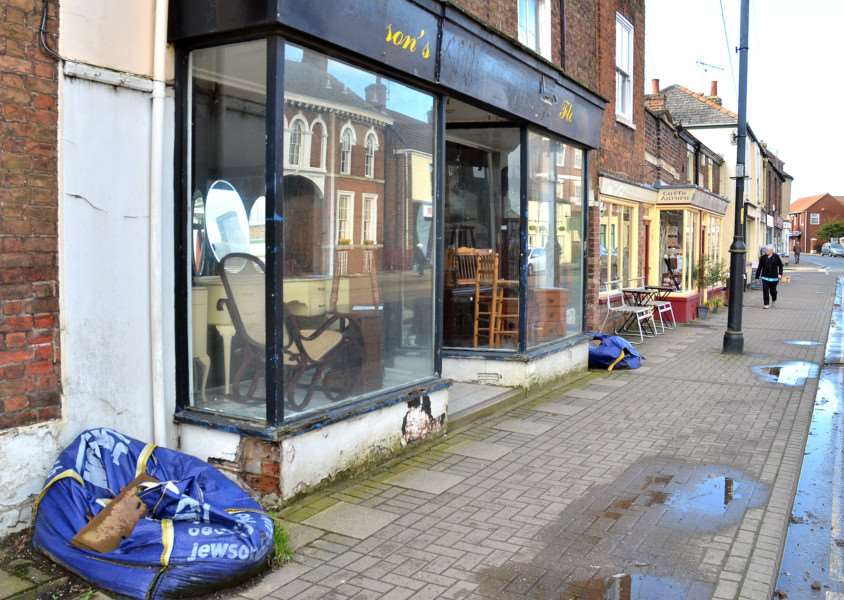Two builder's bags left on Holbeach's High Street for a year are frustrating the town's action group and Holbeach in Bloom members. Photo by Tim Wilson. SG310118-132TW.