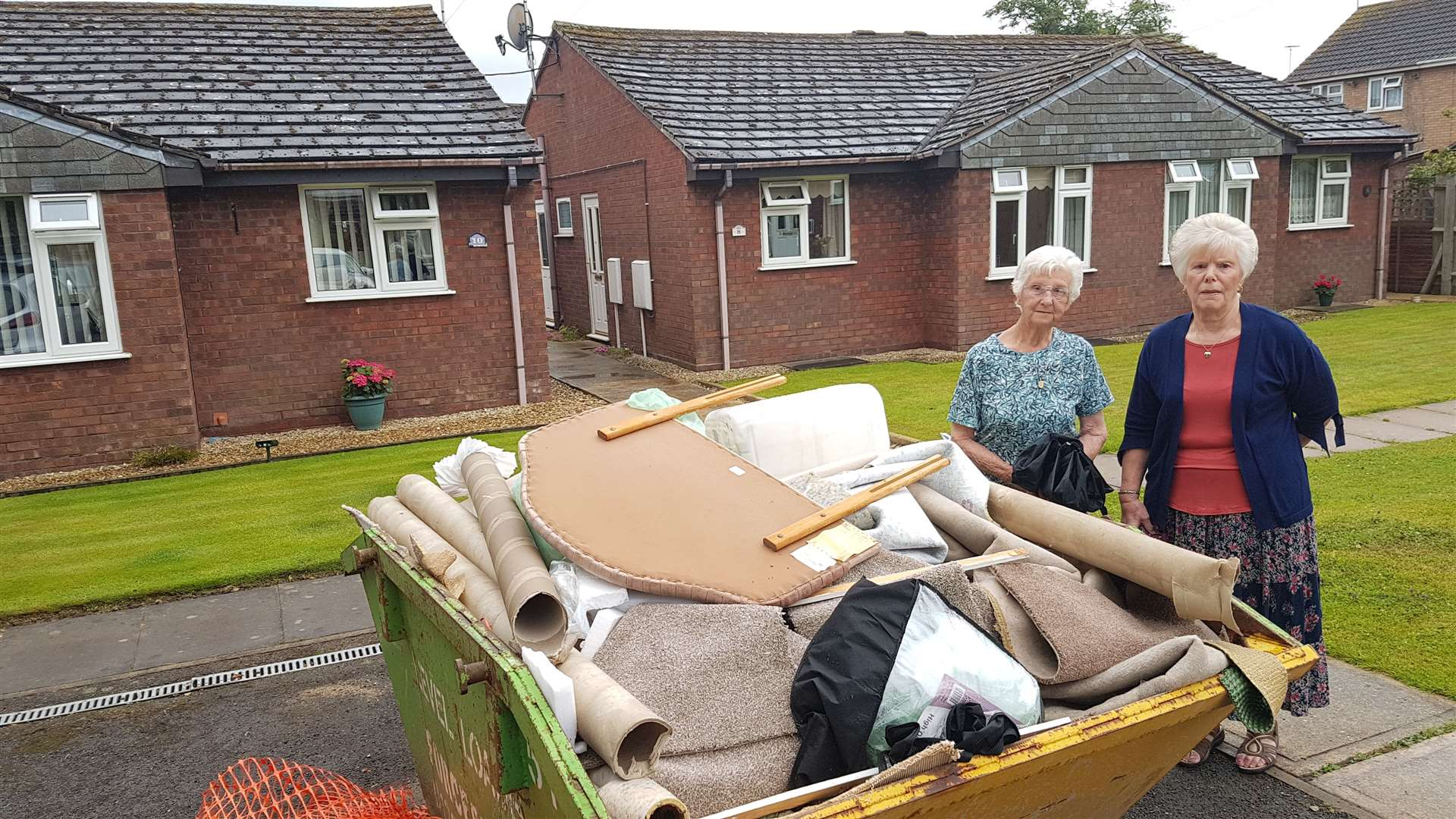 Audrey Forman (left) and Marian Johnson outside their homes in Lyndis Walk, with a skip full of waste and dumped property. (13581206)