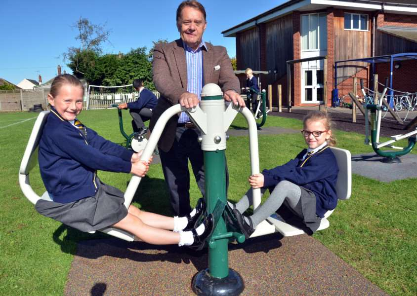 John Hayes MP and pupils try out the gym equipment at St Norbert's Catholic Primary School, Spalding. Photos (TIM WILSON): SG220917-126TW.