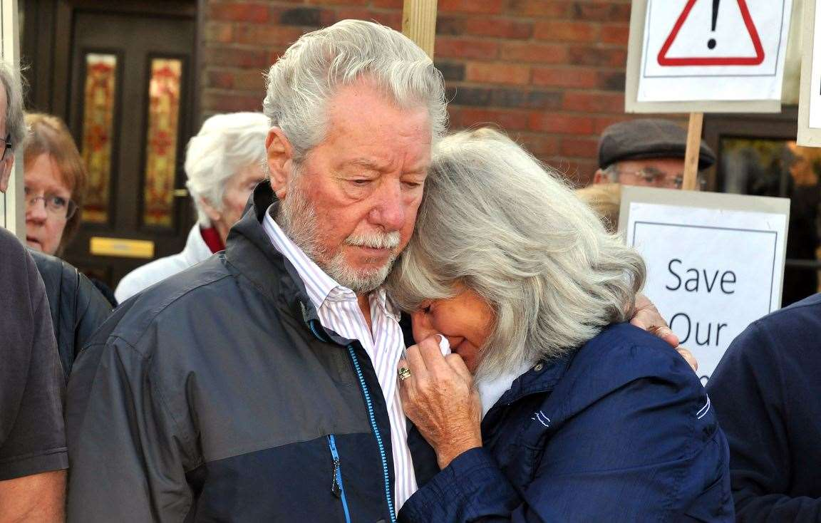 Frank Roberts comforts tearful wife Catherine