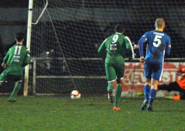 Tom Dugdale levels from the penalty spot