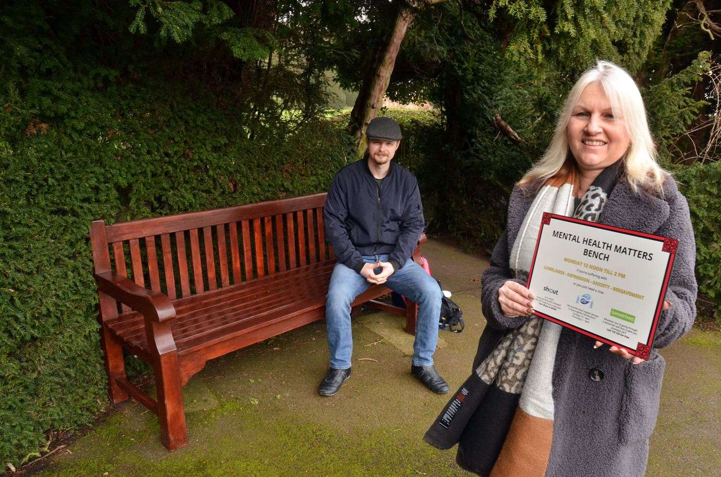 Vanessa Browning and Jack McLean pictured last year with the Community Mind Matters bench in Spalding's Ayscoughfee Gardens. The bench is available for people wanting to chat with a support worker about any anxieties or concerns.