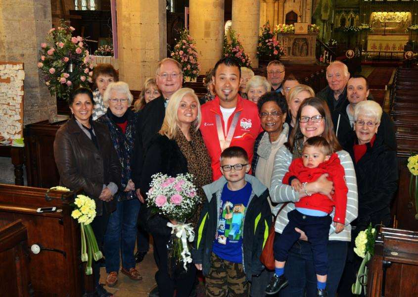 Commonweath Games silver medallist Aaron Heading opened the flower festival at St Mary's, Long Sutton, and he's pictured with his family and church officials, volunteers and visitors. (SG280418-149TW)