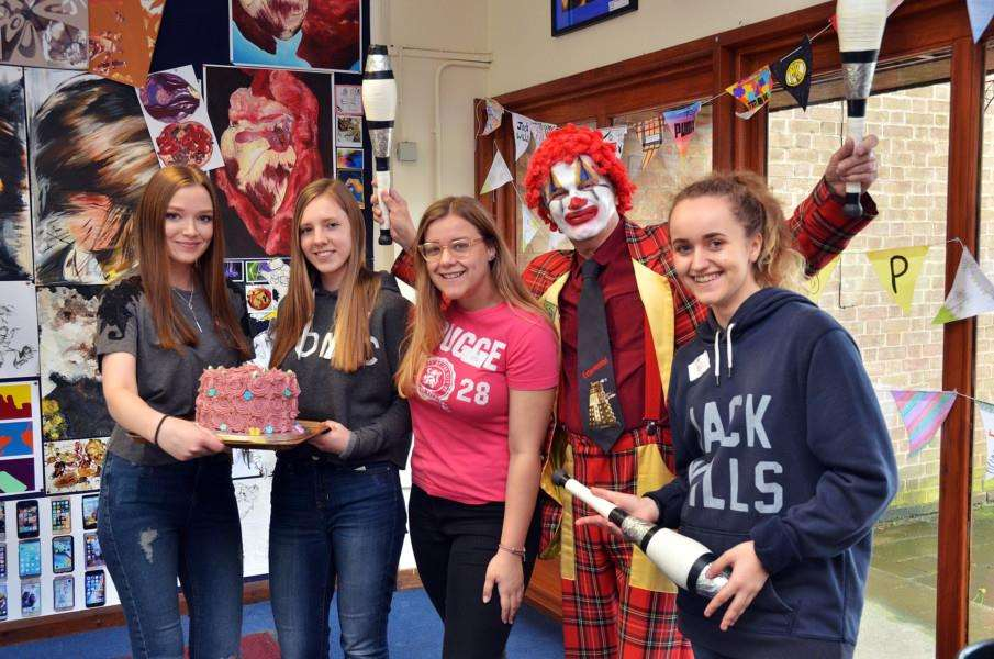 Clown Pedro with fundraising students Charlotte Reston, Aleks Godyn, Lauren Kauw, Molly Smith