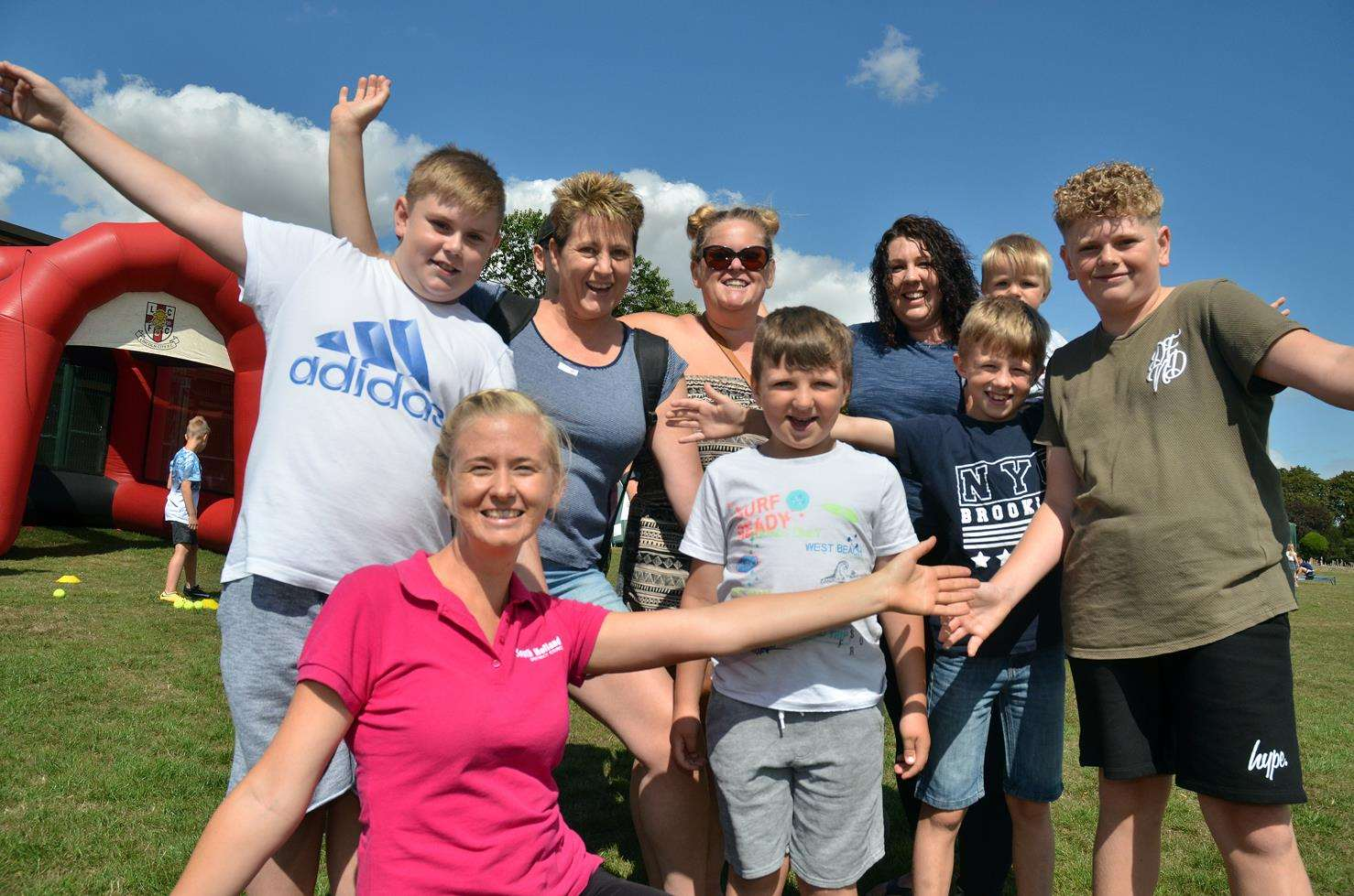 PLAY TOWN:Jessica Horn (front left), of South Holland District Council's communities team, joins families for Activate at Snowden Field, Crowland.Photo (TIM WILSON): SG-080818-103SG
