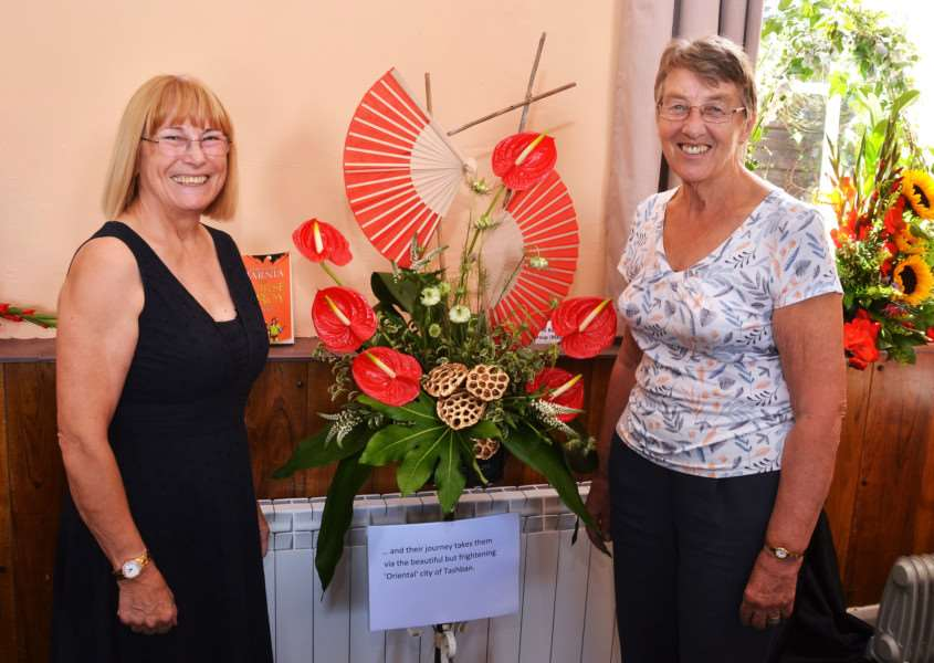 "Maureen Brown and Valerie Manley, of Donington Walking Group, at Gosberton Baptist Church's Flower Festival which had a theme of ""The Lion, The Witch and The Wardrobe"". Photo by Tim Wilson. SG260817-171TW."