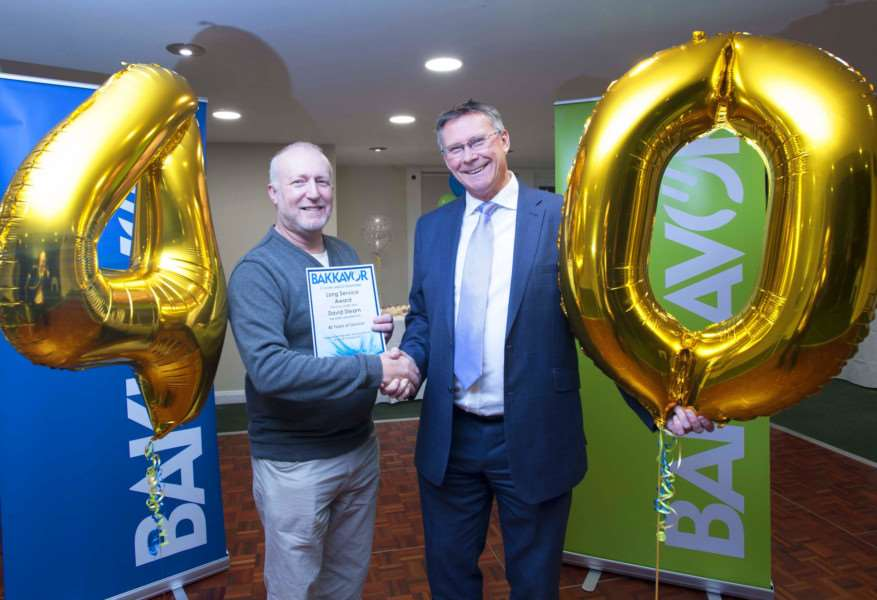 David Stearn is congratulated for 40 years' service by business director Philip West.