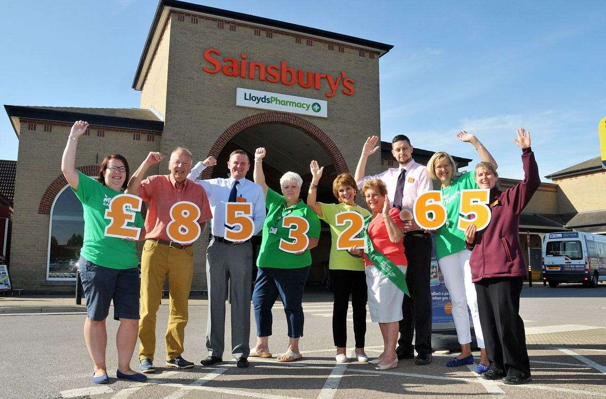 Sainsbury's Spalding present £8,532 to Macmillan. Pictured are, from left, Louise Sharman, Mick Hanson, sales manager John Hunter, Suzanne Cawley, Carolyn Naylor, Christine Brantron, Craig Twell, Macmillan chairman Catherine Stone and Sainsbury's PR ambassador Julie Ward.