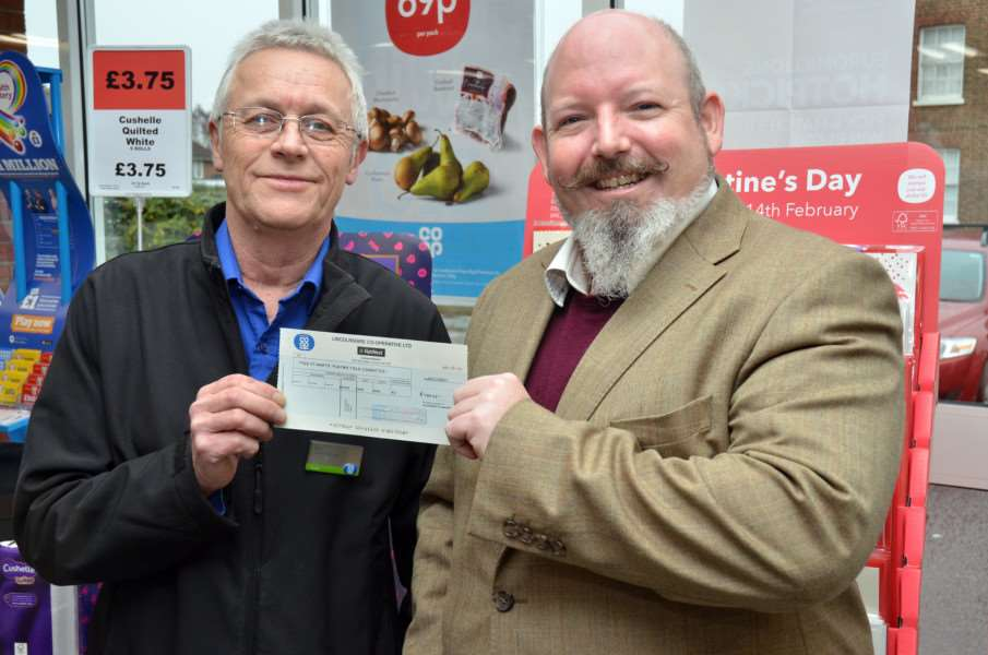 Co-op Community Champions manager Don Winter presents cheque to chairman Rich Bowser