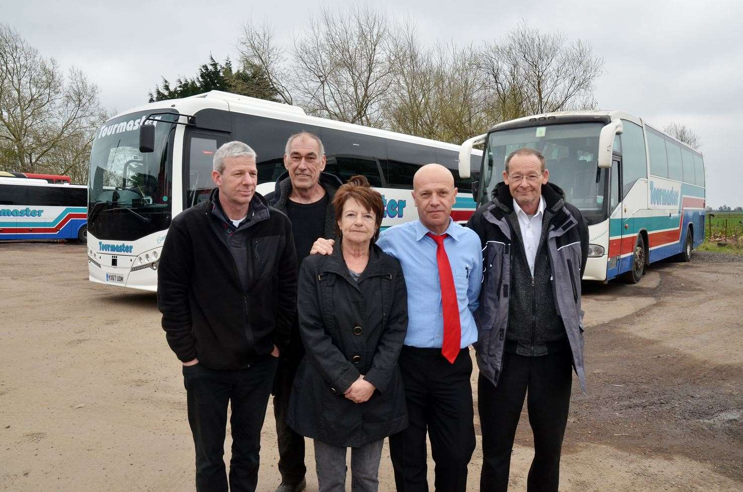 FINAL TRIPS: Driver Rick Marriott, mechanic Malcolm Cooper and director Terri Disney, with drivers Dobri Terziev and Terry Deane, of Tourmaster Coaches in Crowland. Photo (TIM WILSON): SG-220319-006TW