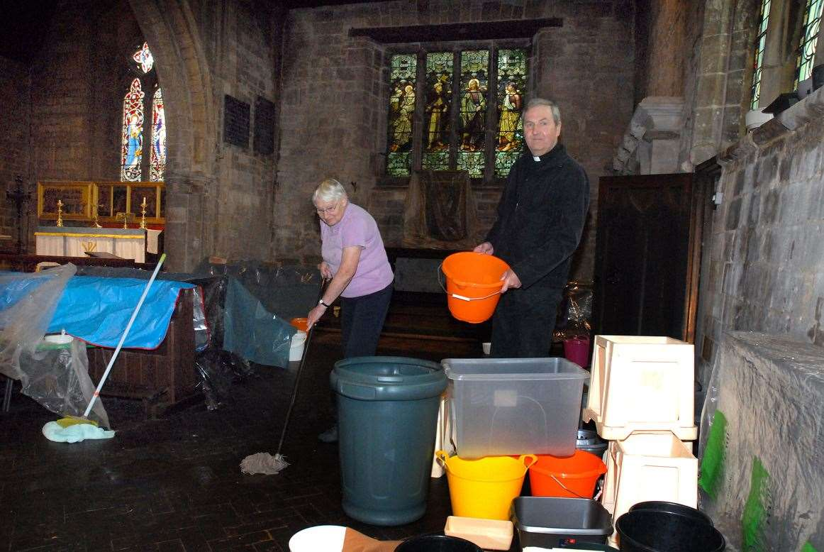 The Rev Ian Walters and churchwarden Iris Bennett in the water damaged Gosberton church after lead was stolen from the roof.