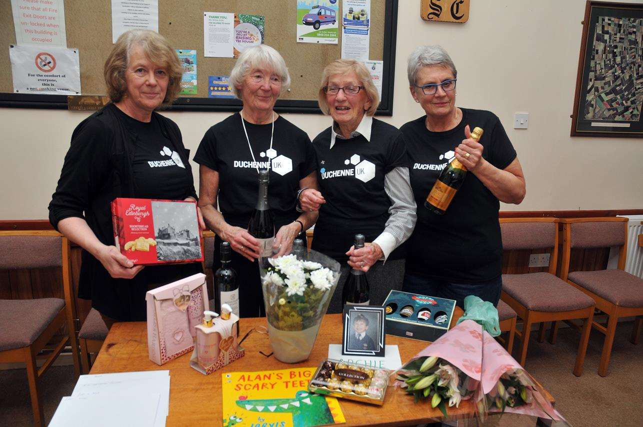 Betty Matthews (second right) with co-organisers Carol Massam, Helen Knight and Shirley Smith at a charity quiz night that raised £520 for Duchenne UK. Photo (TIM WILSON): SG-230219-110TW