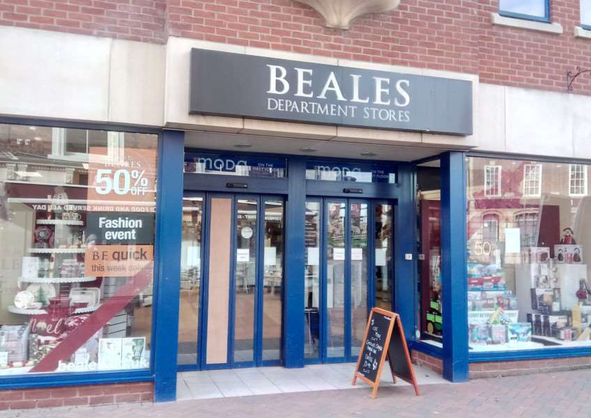 A hammer was taken to a glass door at Beales Department Store before handbags were stolen.