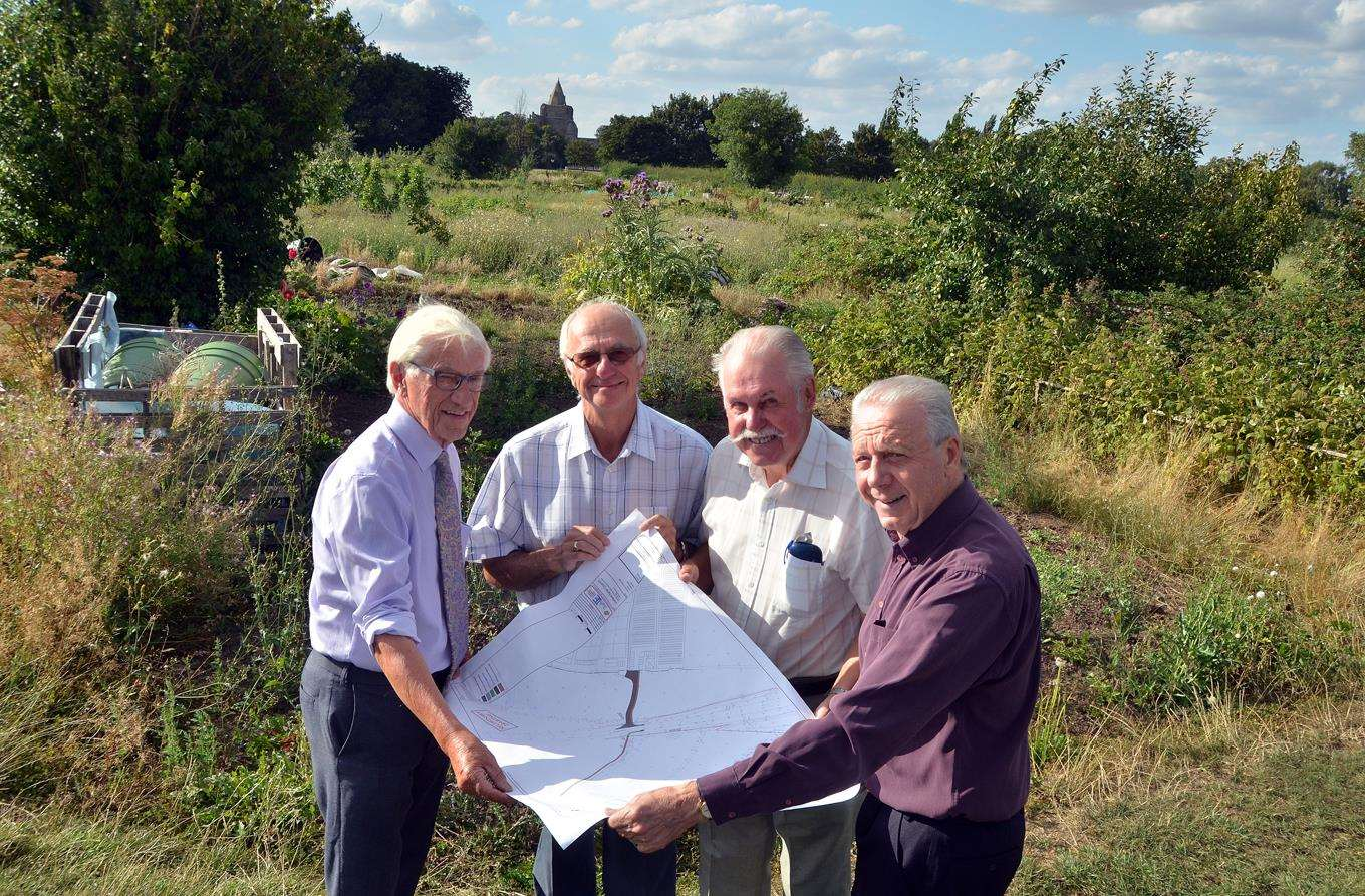 Couns Bryan Alcock, Peter Haselgrove, Reg Boot and David Ringham look at plans forCrowland's new allotments site in James Road.Photo (TIM WILSON): 020818140SG