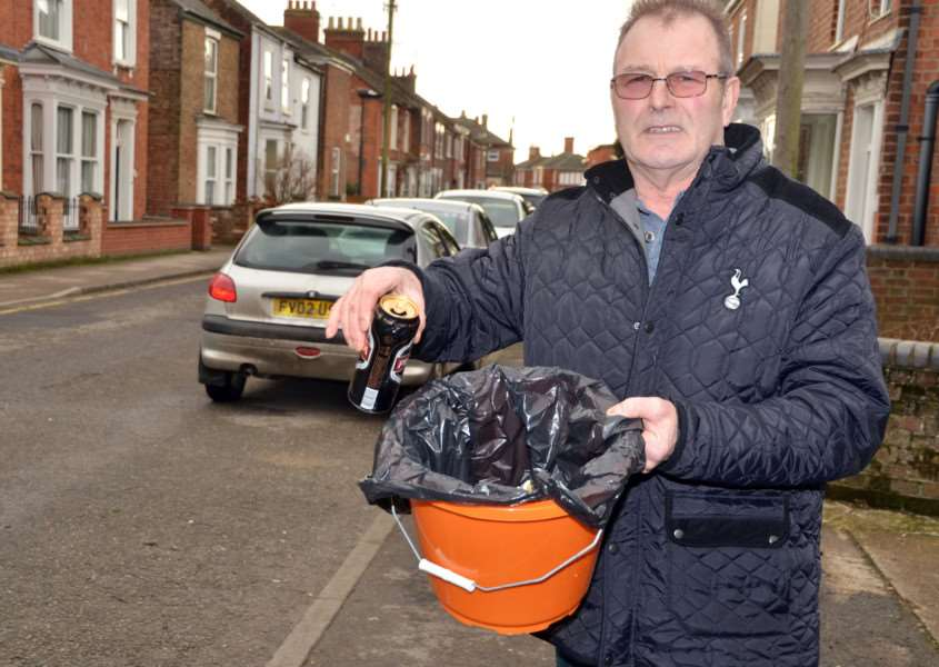 Paddy Dunham with one of the orange buckets put out in Spring Gardens. SG190118-432TW