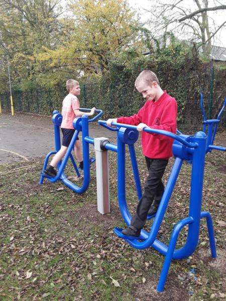 Youngsters try out the new gym equipment.