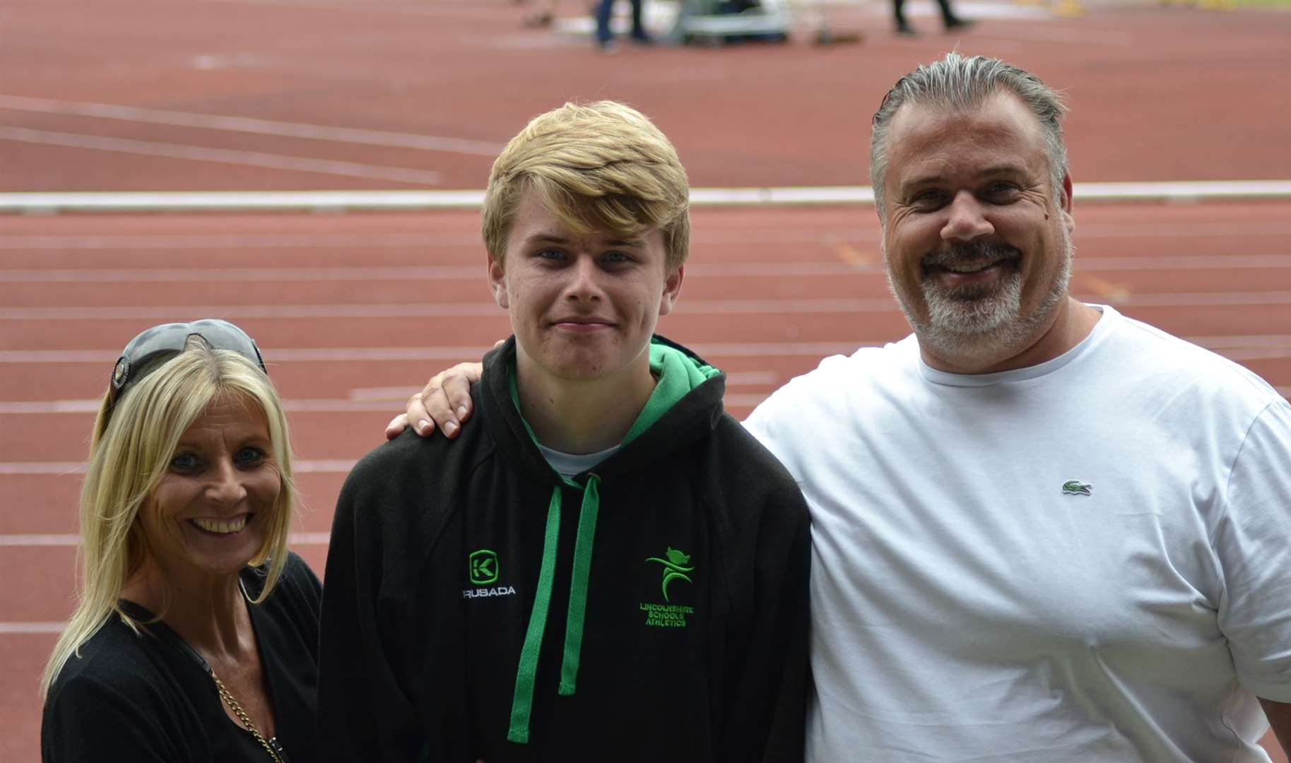Donovan Capes with mum Samantha and dad/coach Lewis after winning the junior boys shot put competition at the English Schools Track and Field Championships in Birmingham.Photo supplied.