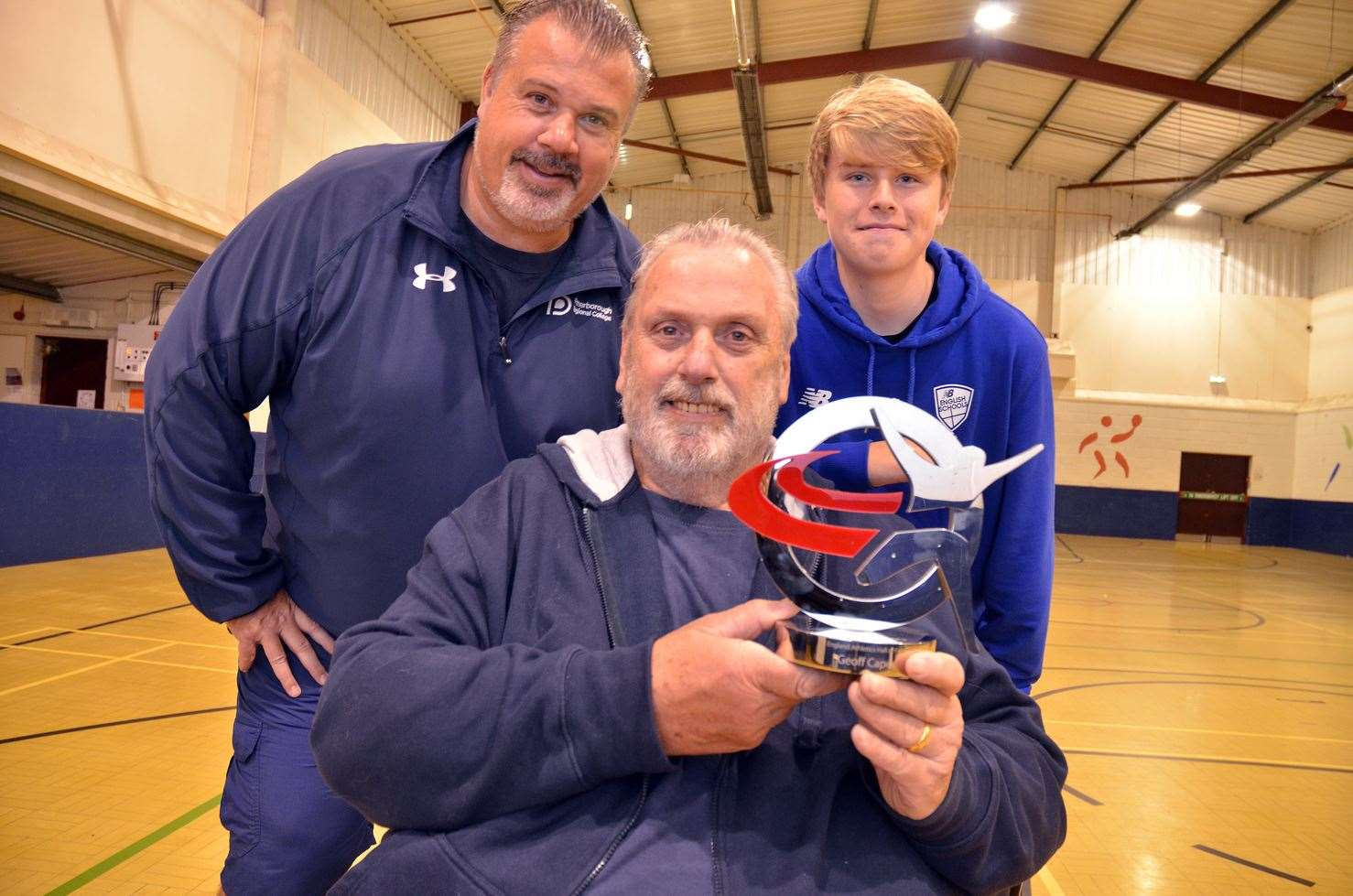 Geoff Capes with his England Athletics Hall of Fame award alongside son Lewis and grandson Donovan.Photo by Tim Wilson.SG-141018-4.